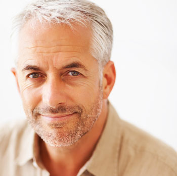 middle-aged man smiling at the camera