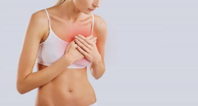 Woman Holding Breast in Pain