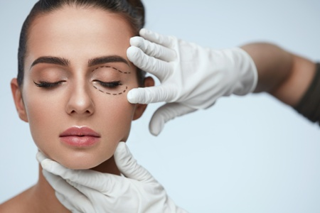 young woman preparing for blepharoplasty | eyelid surgery Denver