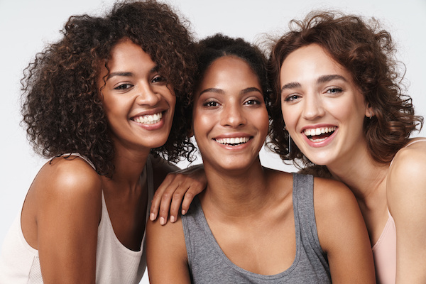 Group of three smiling women