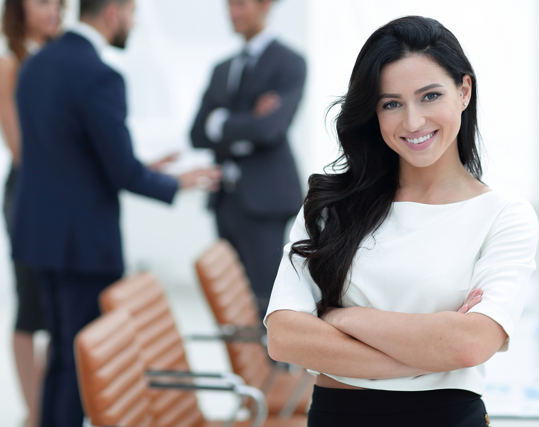 woman in a meeting after returning to work following breast augmentation
