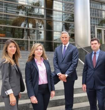 attorneys at the Hickey Law Firm: Sarah Lobel, Claire Armagnac-Rodriguez, Jack Hickey and Christopher B. Smith