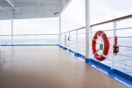life preserver mounted on the railing of a cruise ship deck