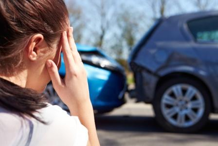 stressed driver looking at the scene of a car accident