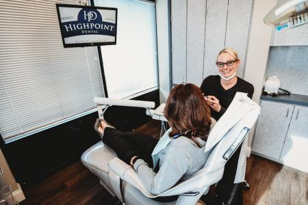 Dental Hygienist at HighPoint Dental giving a consultation