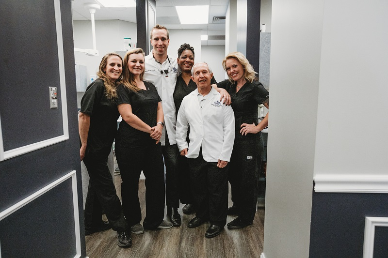 Dr. Justin Baltz, Dr. Merril Rowe, and staff at Highpoint Dental Care | Aurora, CO