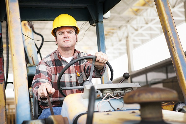 Man Operating Construction Equipment