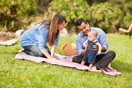 mom, dad and baby at family picnic