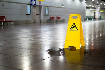 Wet floor sign preventing a slip and fall accident