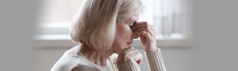 Woman experiencing a migraine