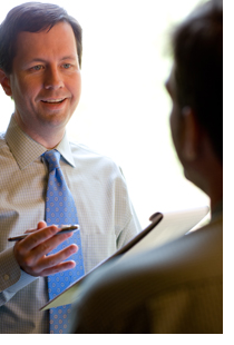 partner attorney J. David Stradley meets with a client