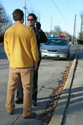 police officer performing a roadside sobriety test