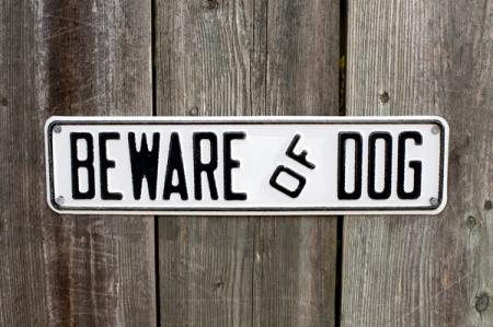 wooden fence with 'Beware of Dog' sign
