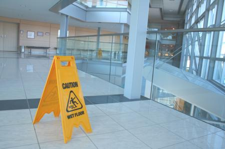 caution wet floor sign in business complex
