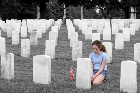 young girl mourning in graveyard