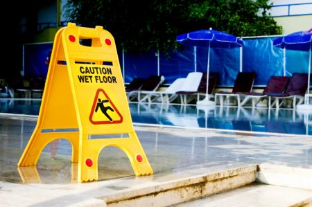 wet floor sign on pool deck