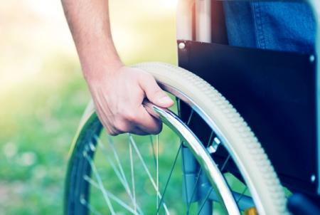 rider hand on wheelchair rim