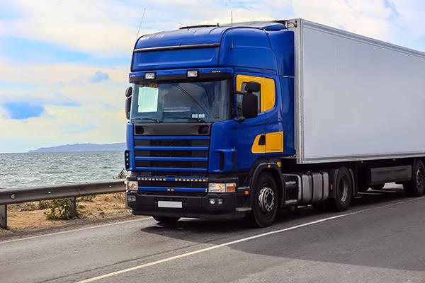 Commercial truck speeds along Naples highway.