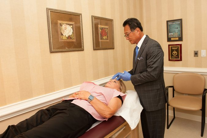 Dr. Paul Kim performing BOTOX Cosmetic injection for female patient