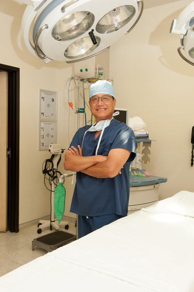 board-certified plastic surgeon Dr. Paul Kim in the operating room at Legacy Plastic Surgery
