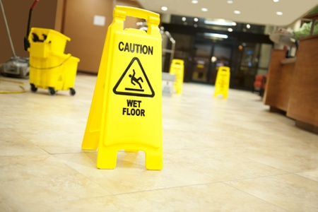 wet floor signs advising of slip and fall danger