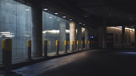 dangerous premises in poorly lit parking garage