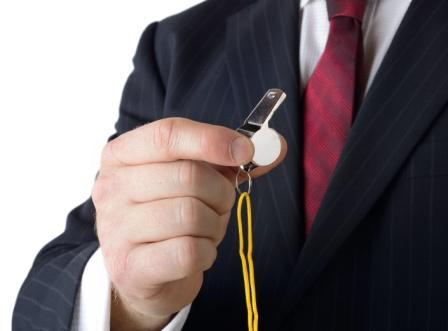 businessman in suit holding a whistle | whistleblower attorneys Colorado Springs