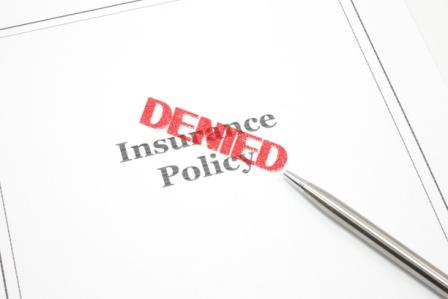 insurance policy document with 'denied stamp'