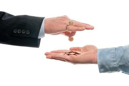 wealthy manager paying worker pennies on the dollar