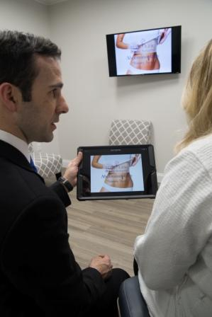 Dr. Raymond Jean meeting with a patient about abdominoplasty surgery | Bryn Mawr, Pennsylvania