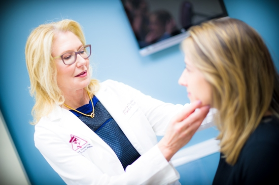 Dr. Gloria Duda consulting with patient about non-surgical face treatment