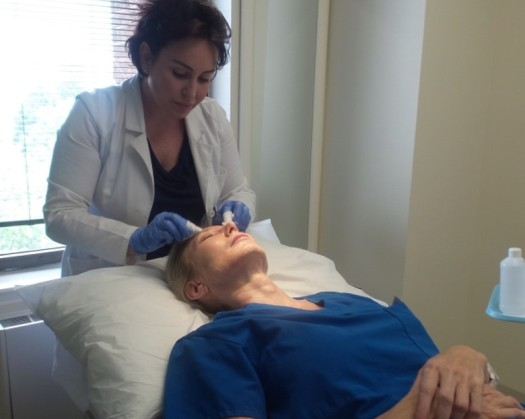 Dr. Duda getting a facial peel from staff member at McLean Plastic Surgery