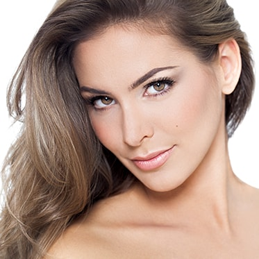 Woman with Symmetrical Face Looking Forward - Facial Plastic Surgery by Dr. Omidi