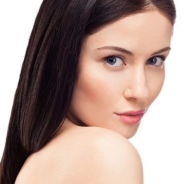 Woman with Clear Skin and No Wrinkles Looking Over Her Shoulder - Non-Surgical Skin Treatments