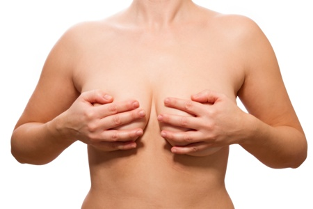 topless woman covering sagging breasts
