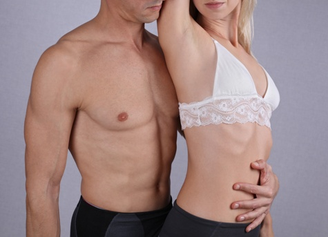 hairless man and woman posing with their shirts off