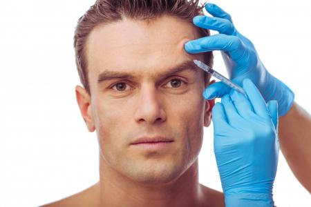 man getting injectable filler in brow