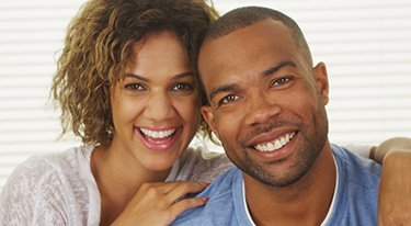 Young Couple with Big, Bright Smiles and Healthy Teeth