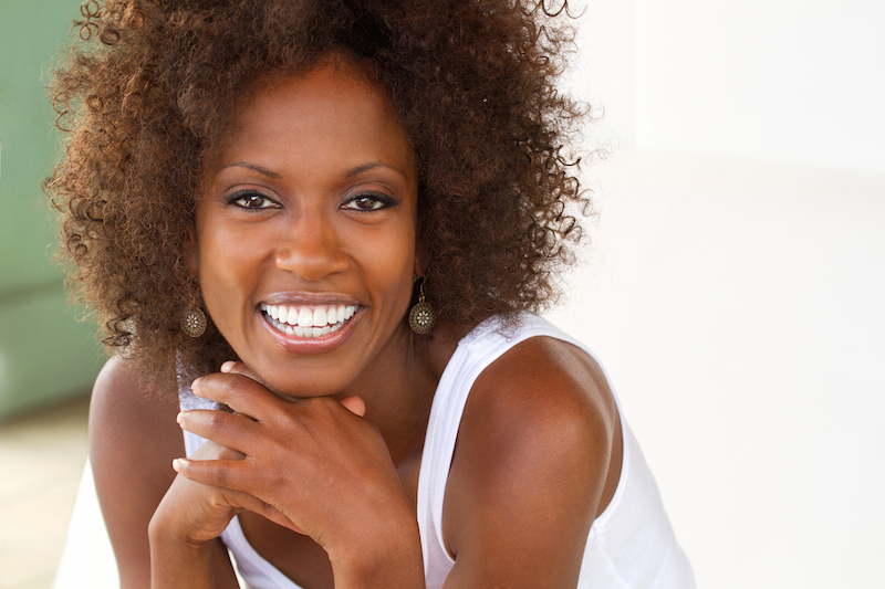 African-American woman smiling, showing her beautiful teeth lengthened from gum contouring | Montane Dental Care