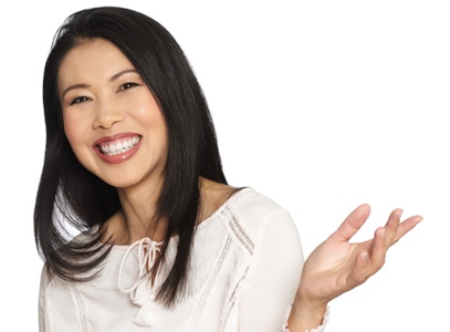 Asian-American woman smiling and holding her hand out
