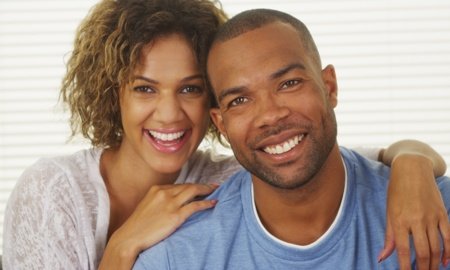 happy African American couple smiling for the camera