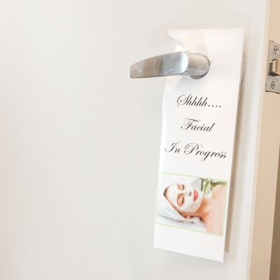 facial in progress sign on a treatment room at our Spruce Grove location