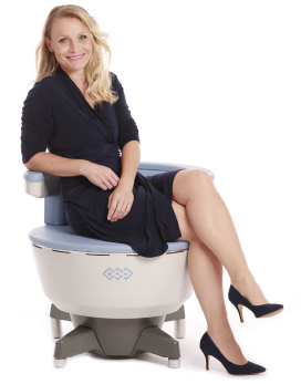 Woman Sitting On BTL EMSELLA Device for Bladder Leak Treatment