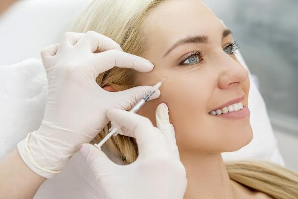 woman receiving injectable treatments for facial rejuvenation