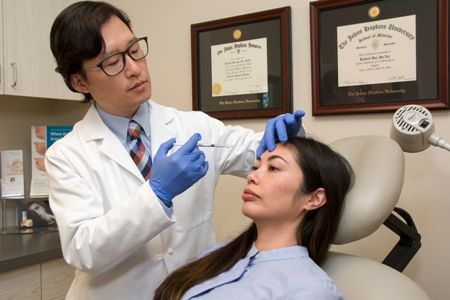 Dr. Lee performing Dysport on a patient in Newport Beach