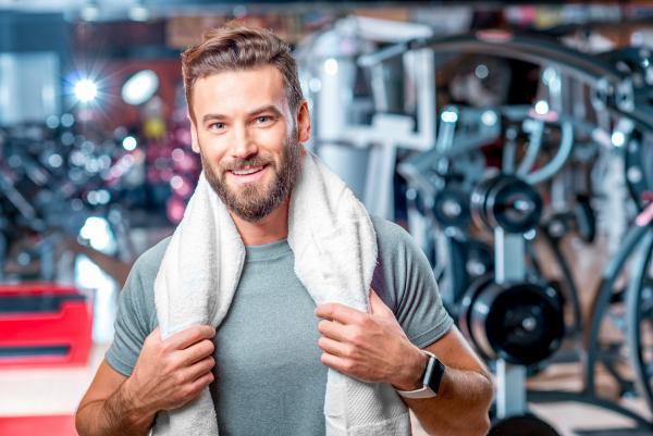man working out after male breast reduction surgery to treat gynecomastia