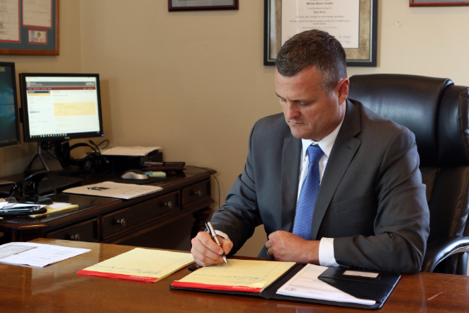 Attorney Noelker working at his desk in his Danville KY office