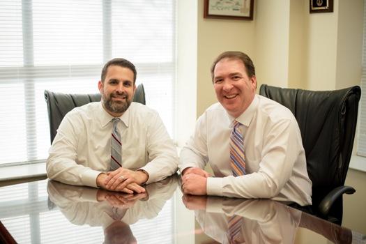 criminal defense attorneys Carlos Wall and Alex Gordon
