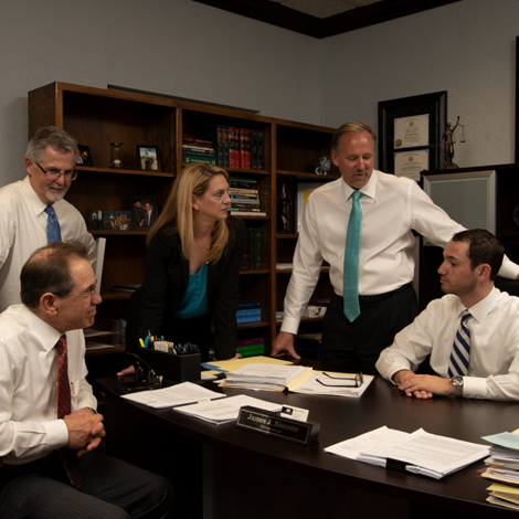 The Lawyers of Johnson and Biscone talking in the office