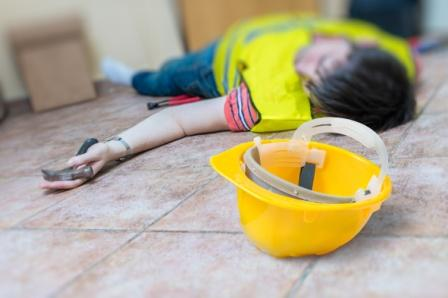 injured construction worker lying on floor